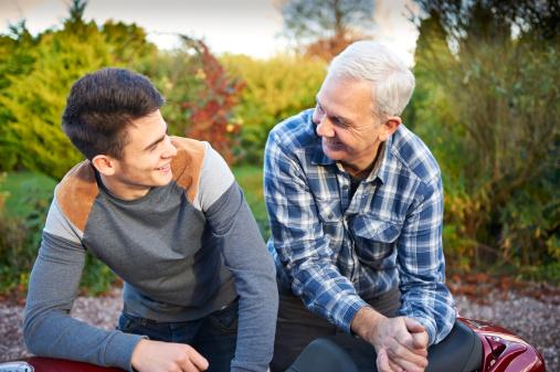 dad and teen boy talking