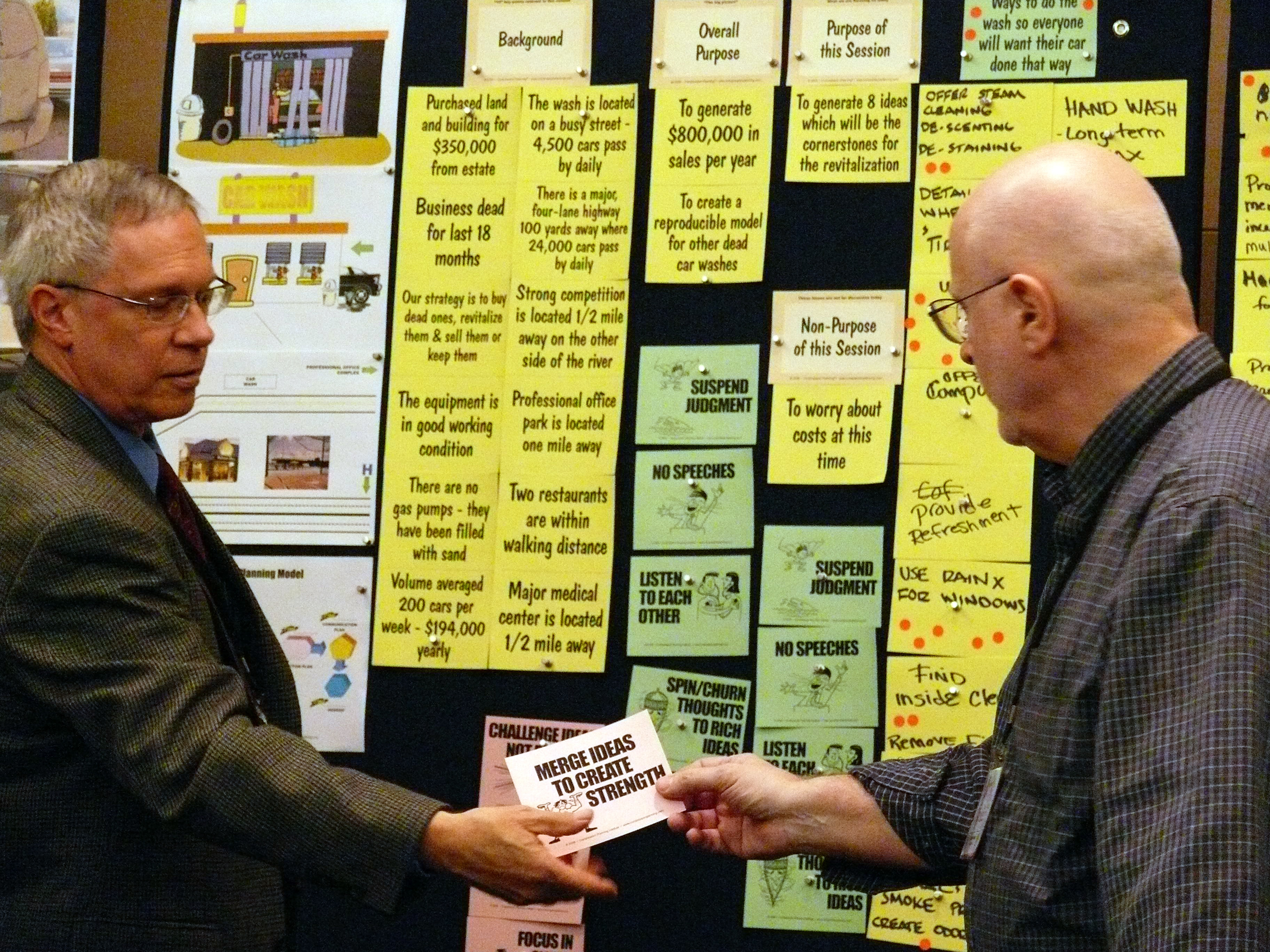 two-men-adding-cards-to-storyboard